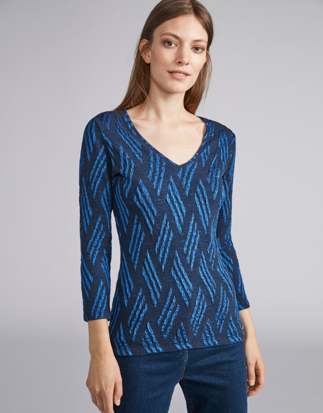 Blue and navy blue knit top with design