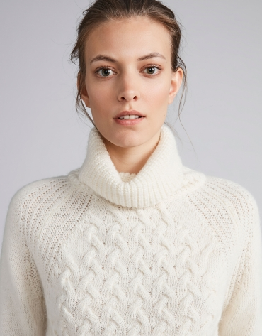 White sweater with stovepipe collar and decoration