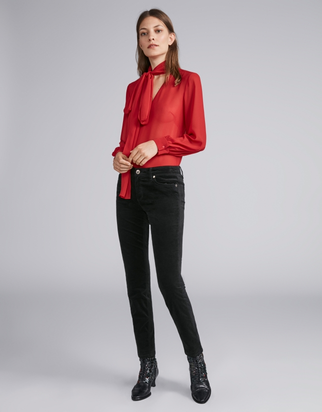 Poppy-colored flowing shirt with tie collar