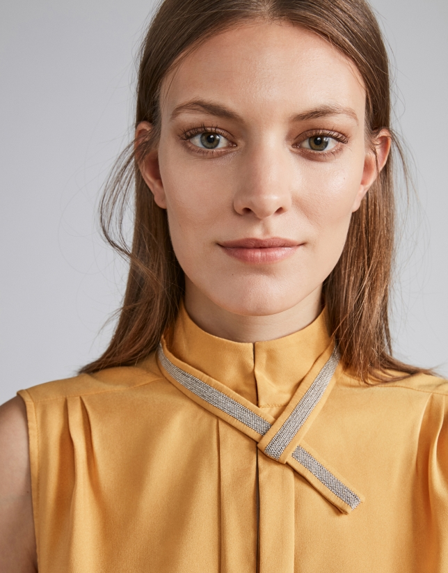 Gold-colored top with decorative collar