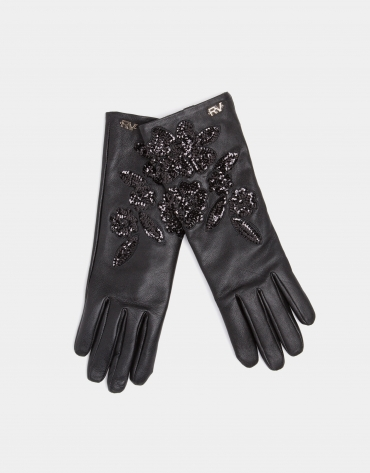 Black leather gloves with print and sequins