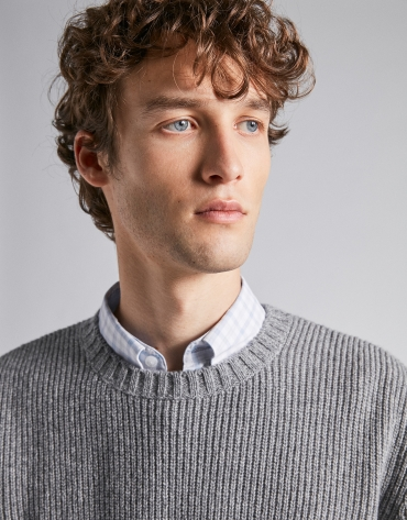 Gray sweater with cable-stitching and raglan sleeves