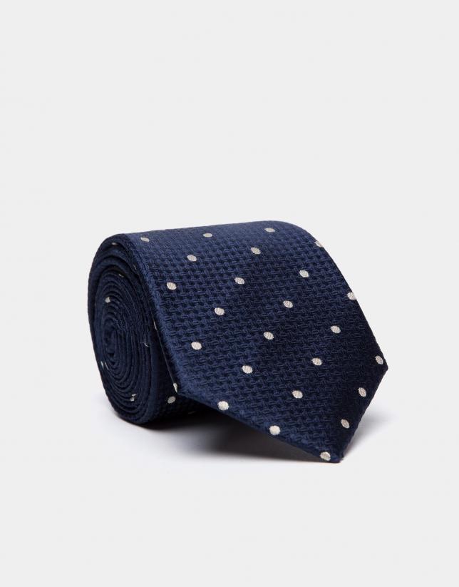 Cravate en soie sur une base bleu marine/noire et des pois couleur écrue