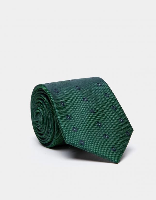 Green silk tie with navy blue geometric jacquard print