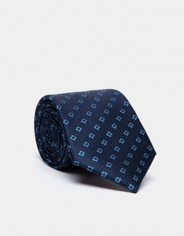 Corbata de seda azul oscuro con jacquard geométrico celeste