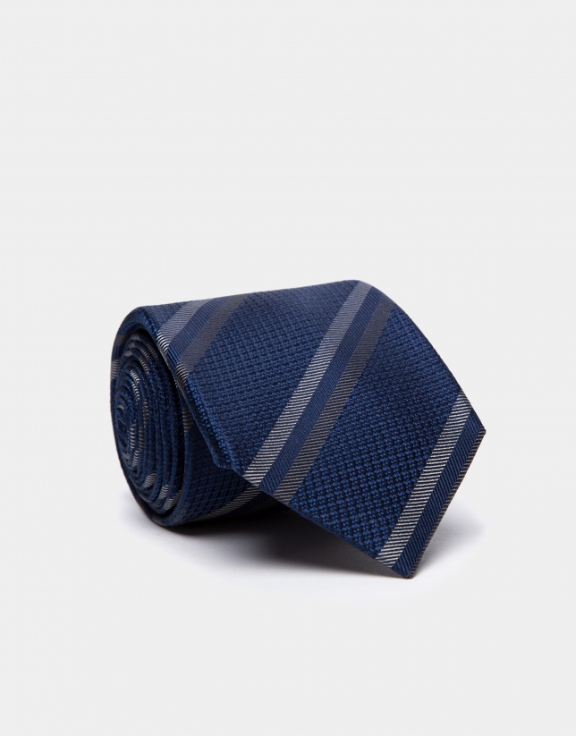 Navy blue silk tie with beige/dark mink-colored stripes