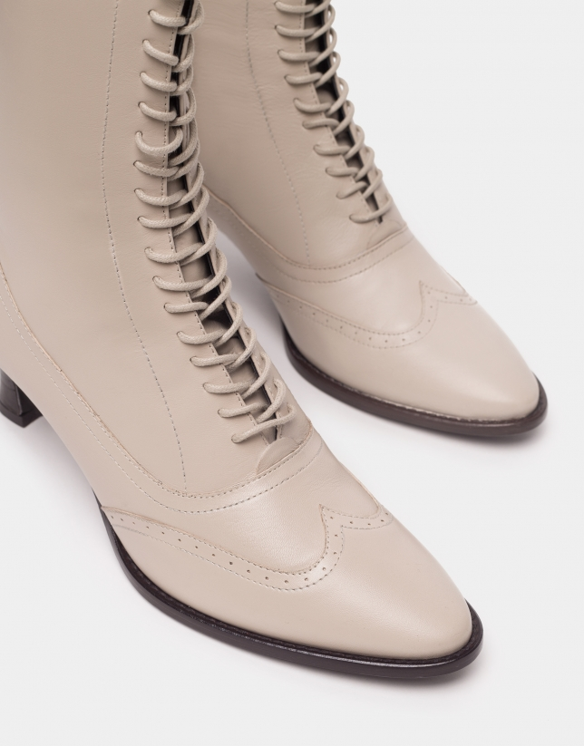 Beige Brogue ankle boots with heels