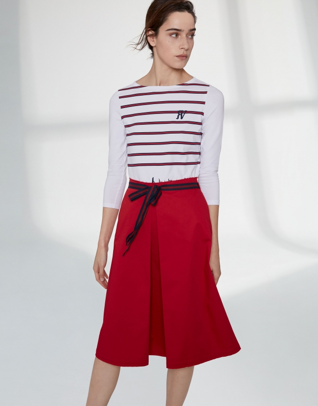 Poppy colored skirt with front fold