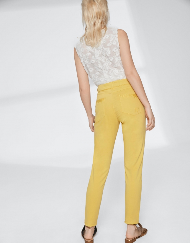 Yellow pants with fringe hem