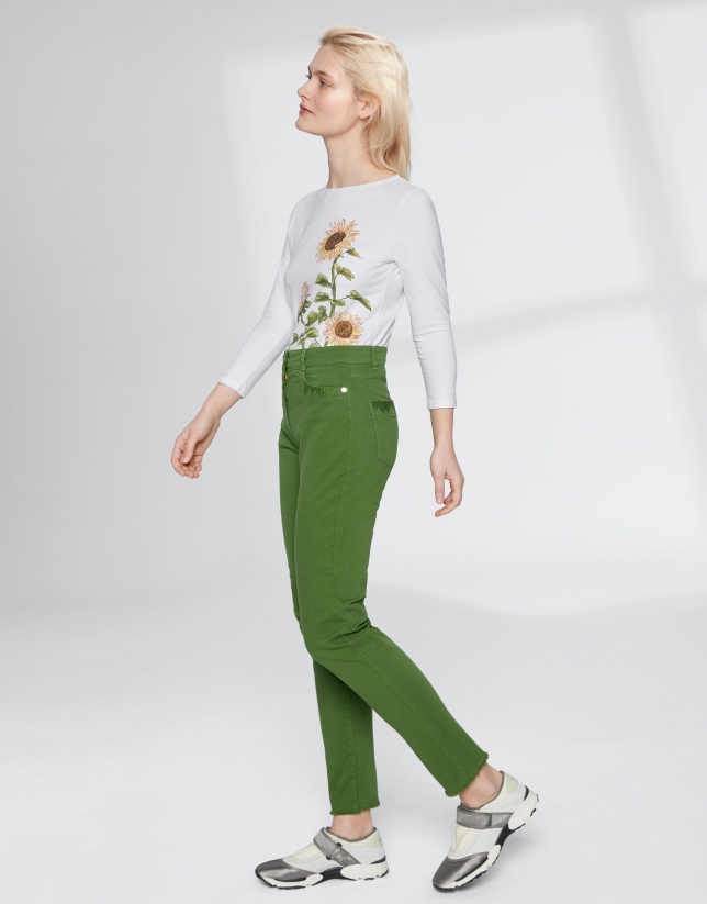Green pants with fringe hem