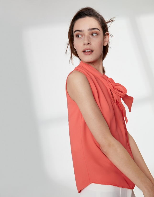 Orange top with bow