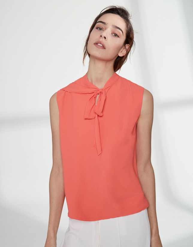 Orange top with bow