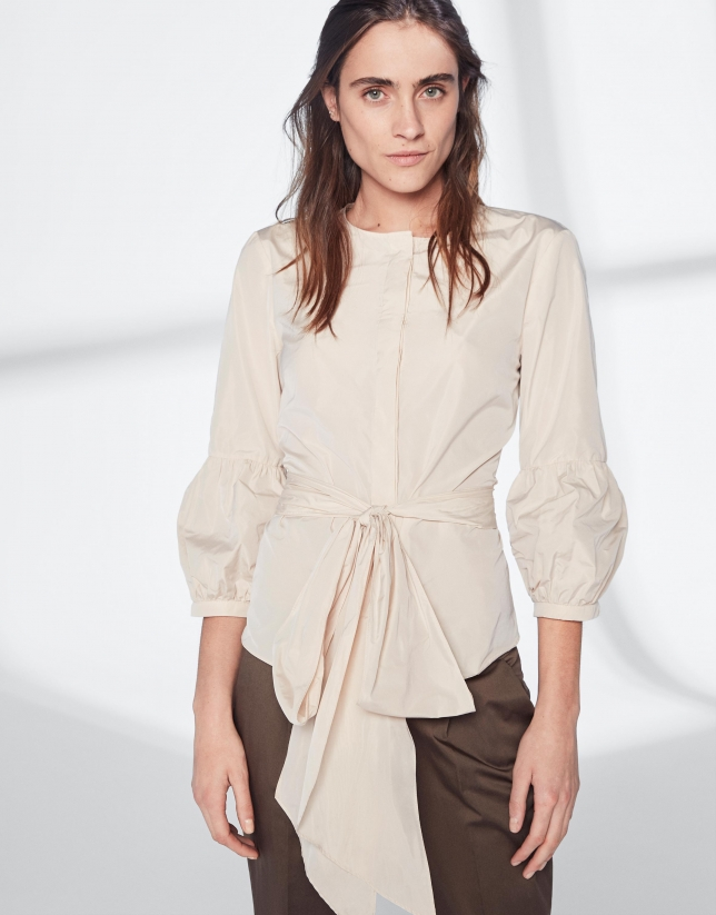 Sandy-colored top with gathered sleeves