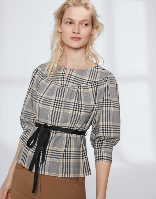 Checked blouse with boat neck and belt