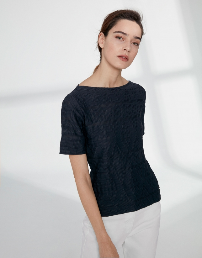 Navy blue top with an embossed fabric