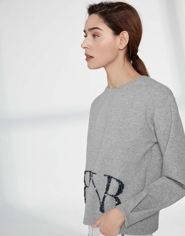 Gray sweatshirt with sequined logo