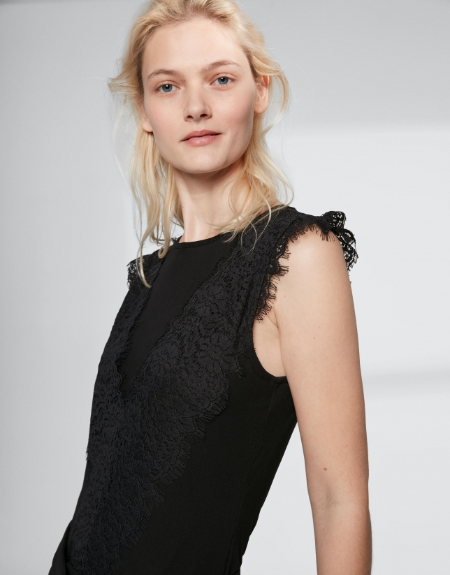 Black top with transparencies and lace