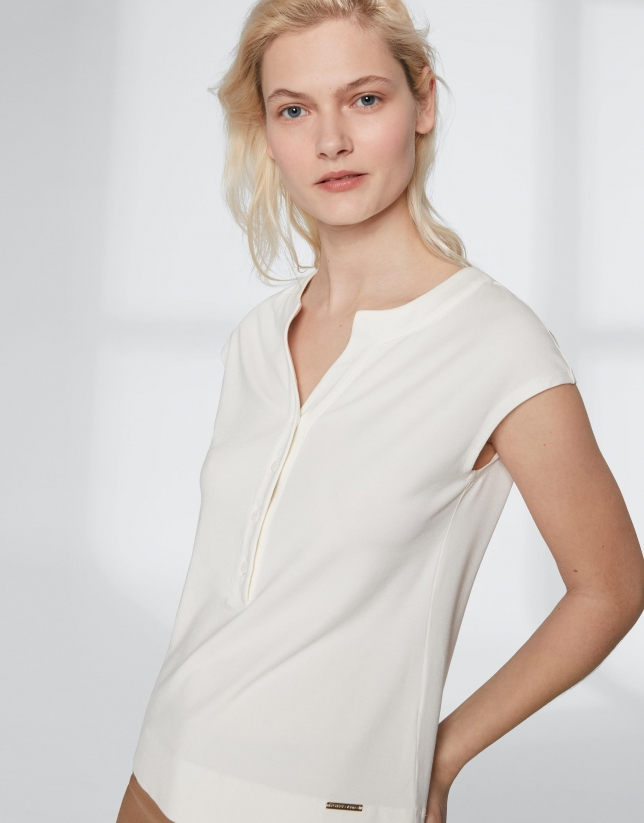 White top with V-neck
