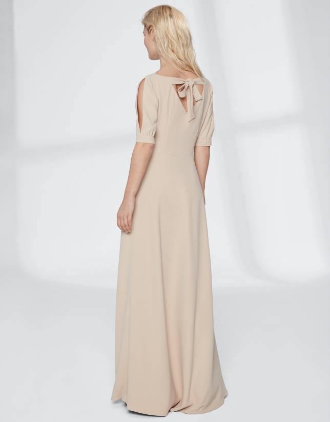 Long, draping, sandy-colored dress