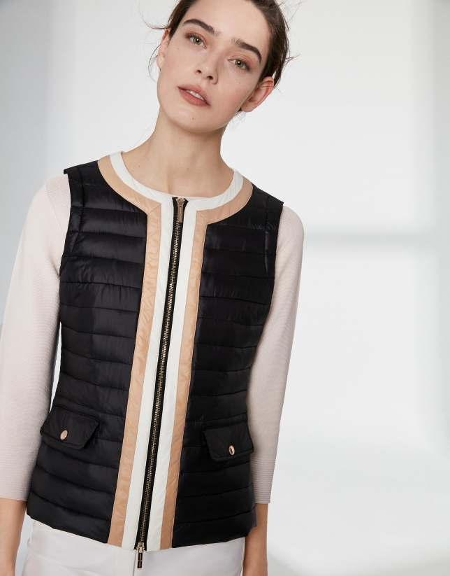 Black quilted vest with contrasting beige
