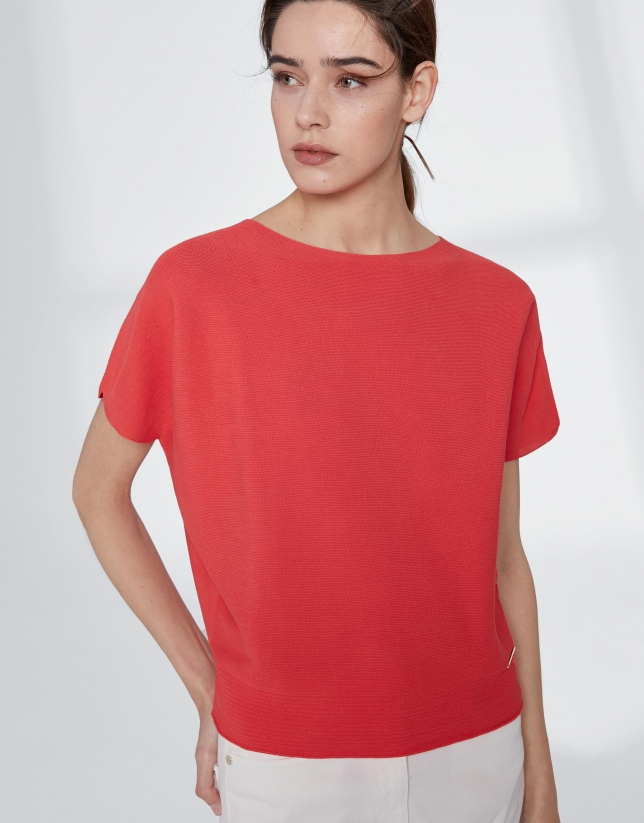 Orange sweater with bat sleeves