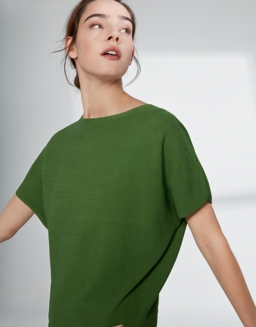 Green sweater with bat sleeves