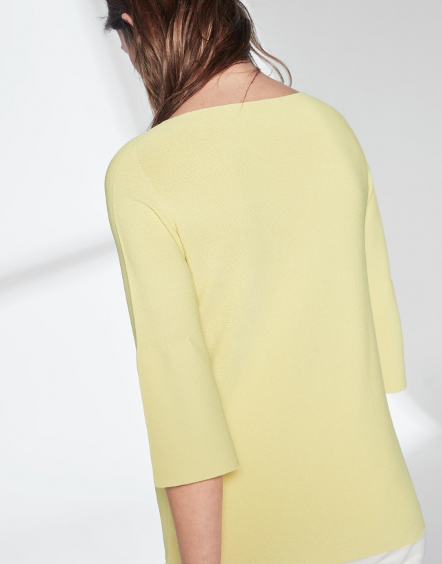 Yellow sweater with flounce