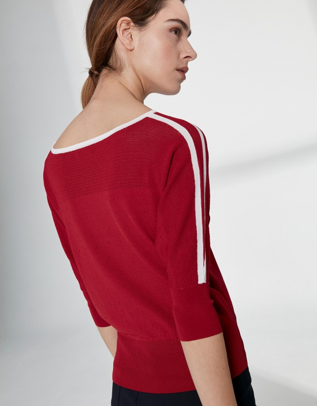 Red sweater with bat sleeves