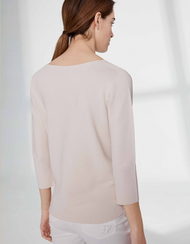Sandy-colored sweater with round neckline