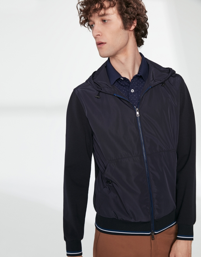 Navy blue tech fabric and knit windbreaker