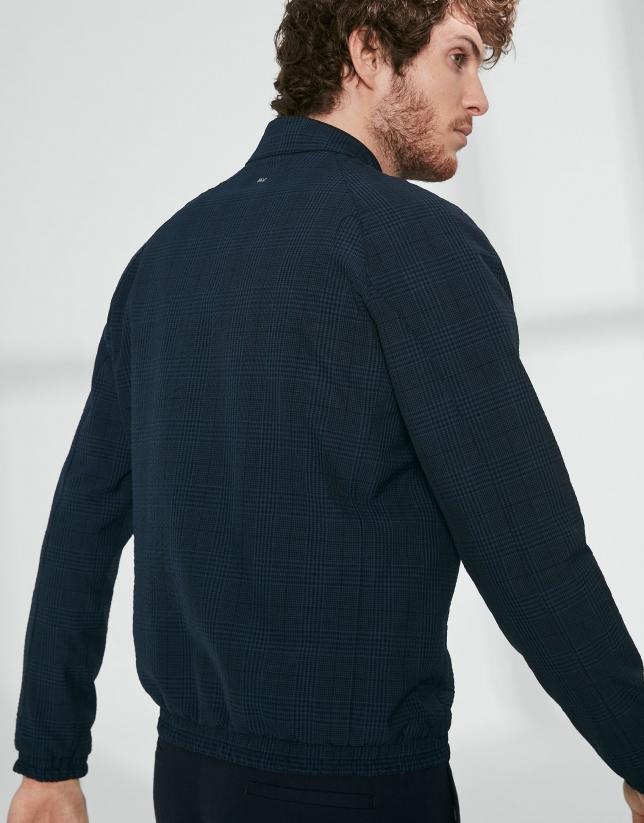 Blouson réversible en tissu technique uni et carreaux
