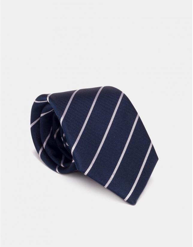 Cravate en soie bleu marine à rayures argentées