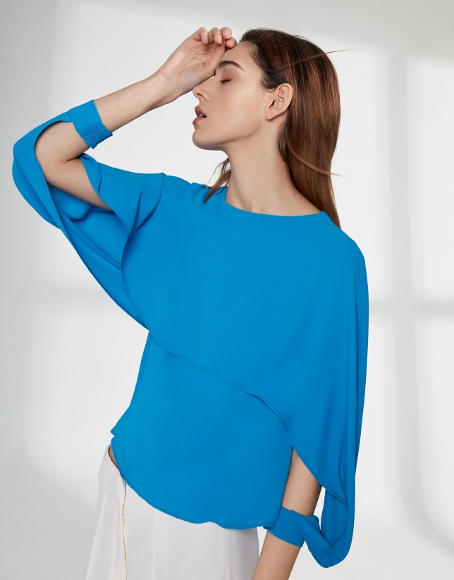 Blue top with superimposed cape