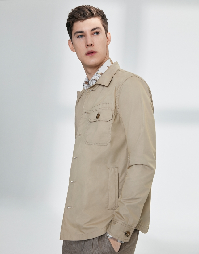 Sandy-colored windbreaker with pockets