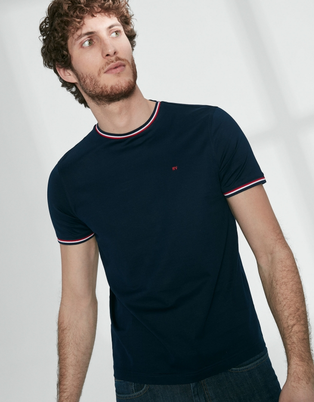 Navy blue top with red ribbed collar