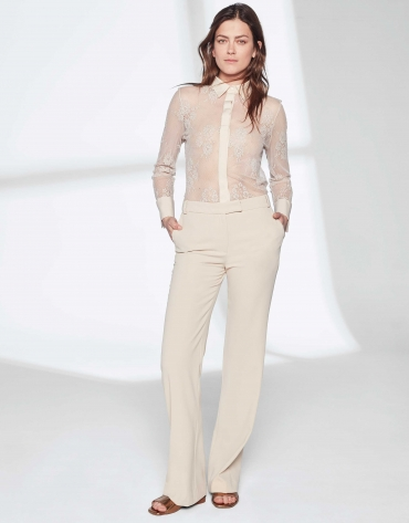 Sandy-colored pants suit