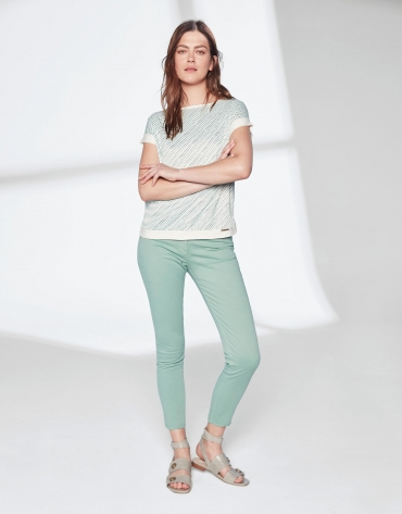 Pastel green pants with fringe hem