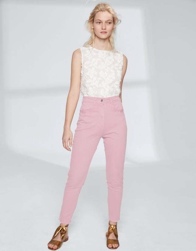 Pink pants with fringe hem