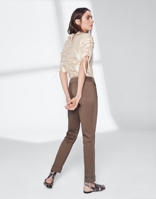 Khaki green pants with turned-up hem