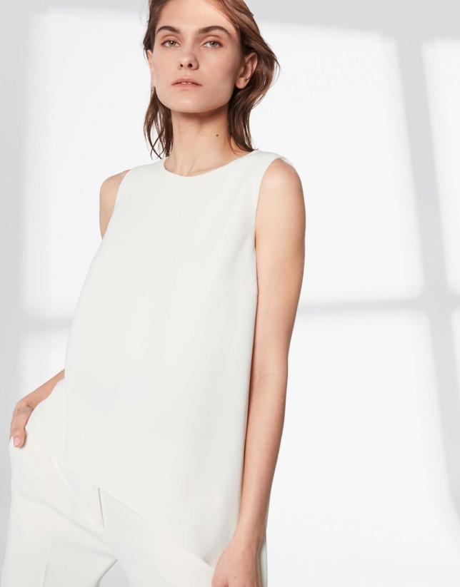 White top with asymmetric hem