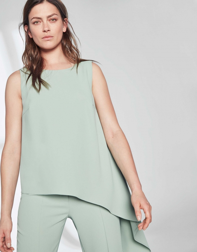Pastel green top with asymmetric hem