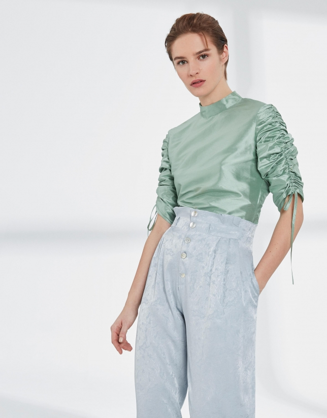 Pastel green silk blouse with puckered sleeves