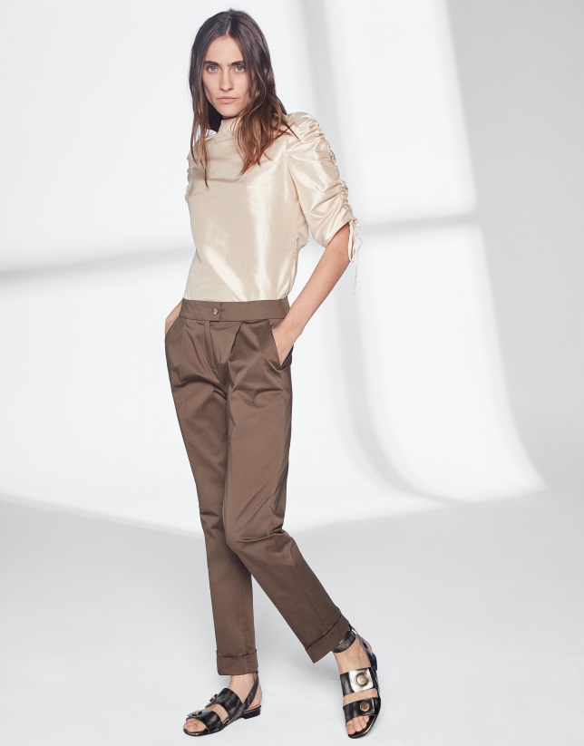 Beige silk blouse with puckered sleeves