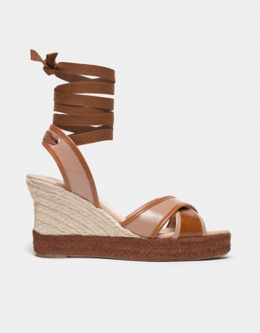 Beige crossover wedge shoes