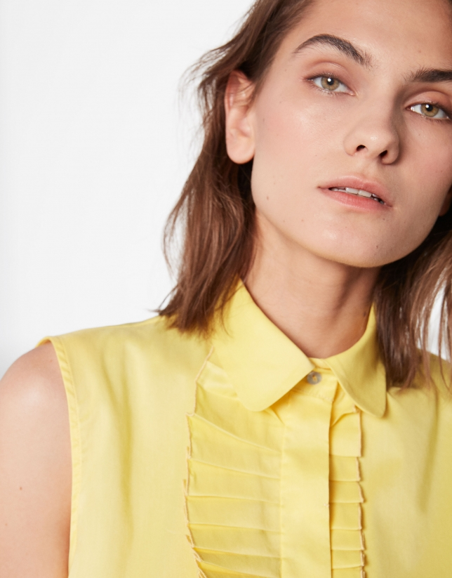 Yellow sleeveless blouse