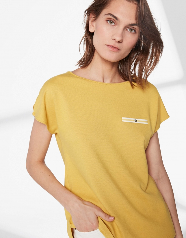 Mustard top with trim on chest