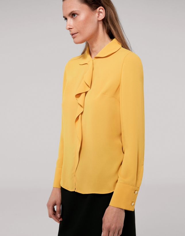 Gold shirt with ruffles