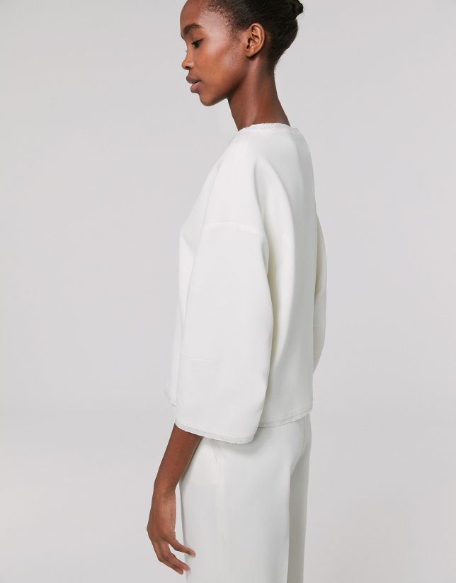 Ivory draped knit top
