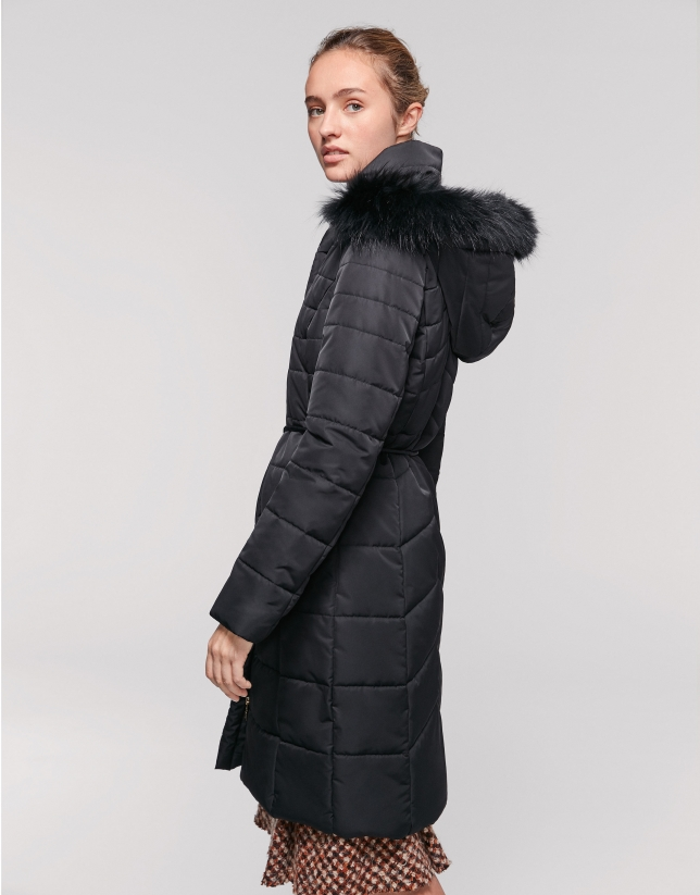 Long black quilted asymmetric coat