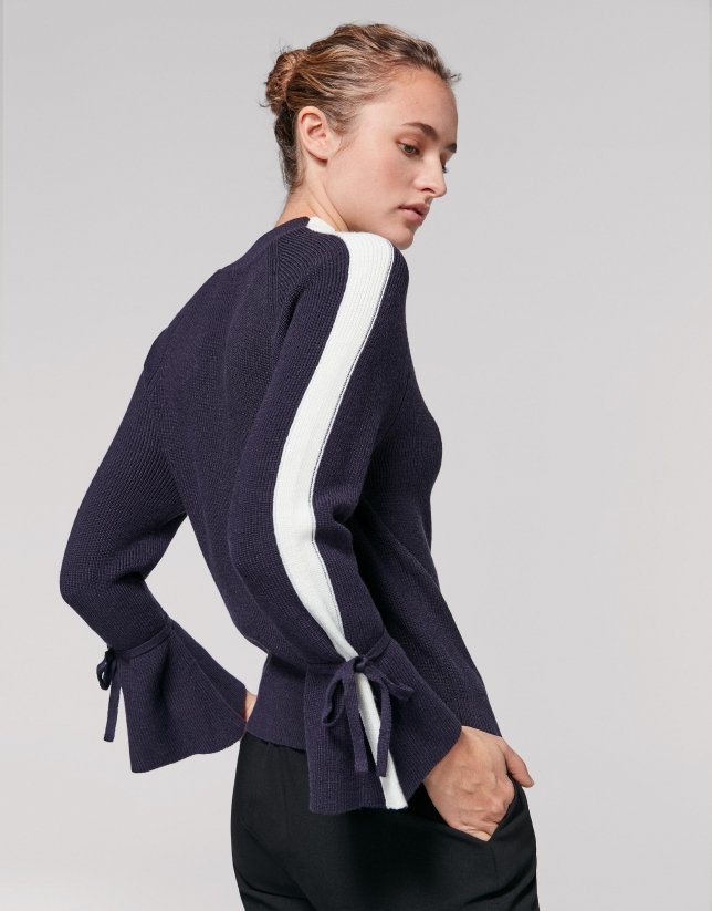 Navy blue sweater with bell-shaped sleeves